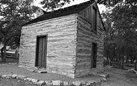 An image of the 1850's built Liebelt Cabin now in place next to City Hall as a Lakeway historical